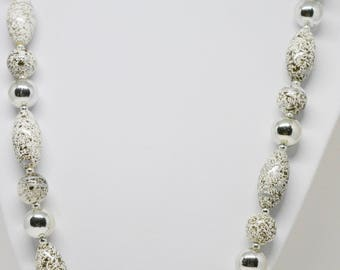 Lovely white tone beaded necklace