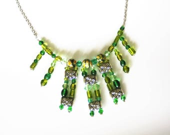 With variegated green on stainless steel chain necklace