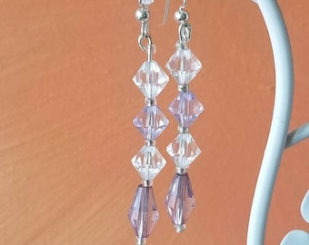 lavendar color and clear colored crystal like beaded earring