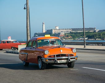 Classic car driving on the Malceon in Havana Cuba, 50's decor, cuban art, cuba photography, clasic car, home decor, orange, mercury car