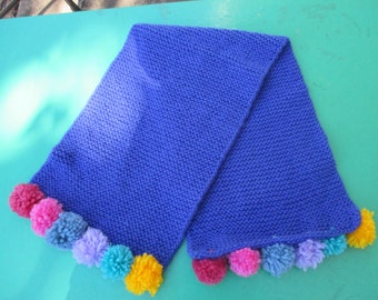 Childs Blue Hand Knitted Scarf with colourful Pom Poms