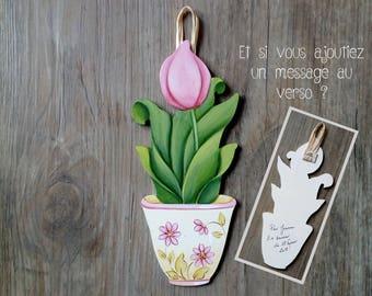 A single pink tulip in a porcelain vase