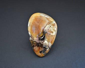 Simbircite-ammonite with pyrite natural stone cabochon 48 х 32 х 6  mm