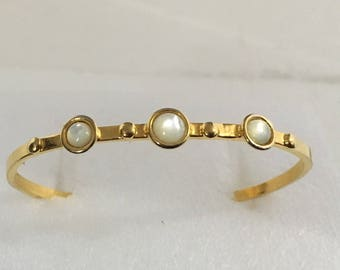 Gold plated brass cuff bracelet with mother of pearl stones