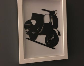 laser cut scooter in a frame