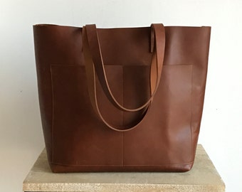 Oversized Tan / Cognac Leather tote bag with outside pockets. Cap Sa Sal Bag. Handmade.