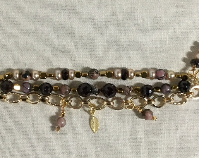 Triple strand charm bracelet with garnet, pink jasper, pearls, and hematite