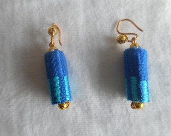 Cylinder shaped Earrings fashioned with African print.