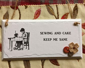 Sign for Sewers: 'Sewing and Cake Keep Me Sane'; With Buttons & Burlap Flower Embellishment. Wooden Door Sign for Sewers. Sewing Gift.