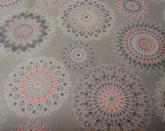 Printed cotton fabric patterned rosette on a grey background