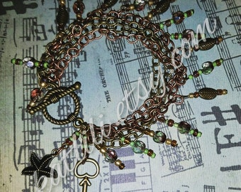 Mixed metal chain and green bead charm bracelet