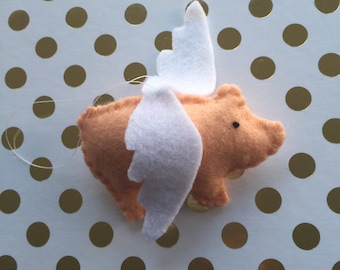 Pigs might fly. Felt pig danglie with wings