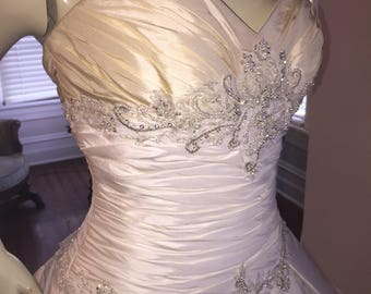 Gorgeous sweetheart strapless bust line designer Casablanca 2 toned beaded  wedding gown with train