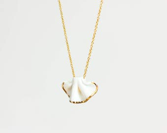 Ceramic necklace white and gold with gold chain.