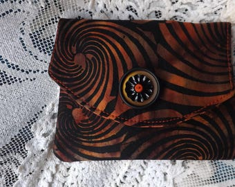 swirls of  black and orange wallet/card holder