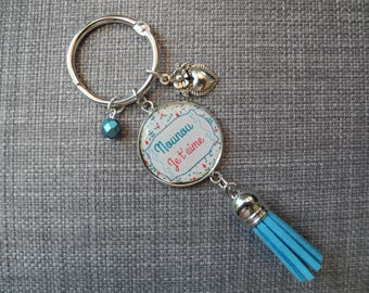 "Keychain Silver ""Nanny, I love you"" with tassel, bead and charm."