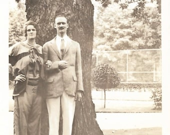 """Vintage Photo """"Going On A Silly Walk"""" Very Tall Man Long Legs Tall Wife Found Vernacular Photo"""