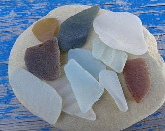11 sea glass pieces 0.8''- 1.8''[2-4.5cm]. Genuine natural beach glass. Surf tumbled glass for various crafts and jewelry making.