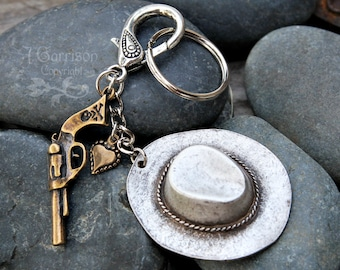 Cowgirl in love keychain - large antiqued silver cowboy hat, bronze heart, and outlaw gun on a silver key ring - free shipping USA