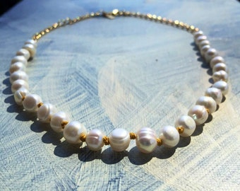 Freshwater pearls on silk yellow knots