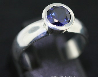 Blue Sapphire Ring with Tapered Bezel