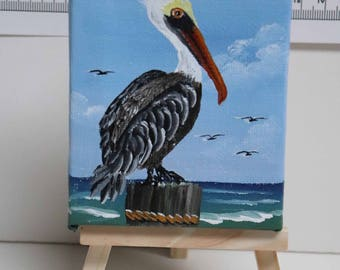 """Beautiful Pelican On a Piling in Shem Creek Near Charleston, SC.  Hand Painted 3"""" X 4"""" on 6"""" Mini Easel"""