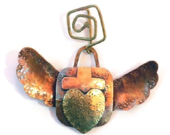 Sacred heart pendant with wings
