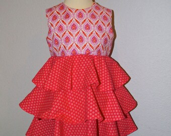 Colors That Pop! An intricate bodice is enhanced by pink polka dots on this girls dress, lined with 3 tiers - Size 2T-3T