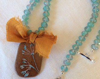 Rustic nature pendant impressed with plant, beaded necklace with Sari silk ribbon
