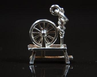 vintage silver bracelet charm spinning wheel