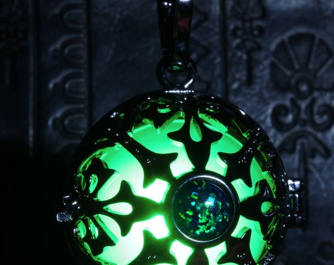 Glowing necklace pendant, locket with green glowing LED orb and green black opal stone