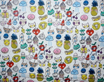 SALE - Fabric - Rico - Quirky faces and icons on white print - knit/jersey cotton 0.65m remnant.