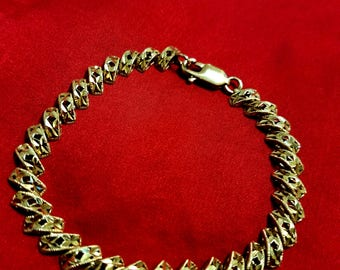 10 kt Gold Bracelet that is great for him
