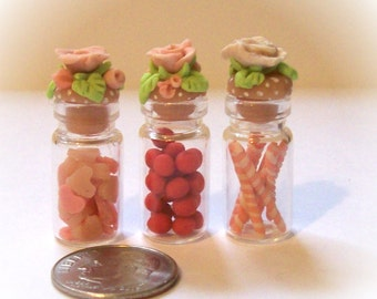 Pink Sweets in Fancy Miniature Glass Bottles Delicate Dollhouse Decor Hand Sculpted Rose Lids and Tiny Handmade Candies - Set of 3