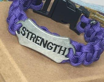 Purple paracord bracelet with strength charm