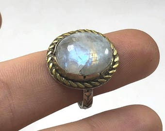 SIMPLE MOONSTONE RING: Sterling silver and brass, featuring a Rainbow Moonstone