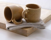 Two tankard style stoneware pottery tea mugs - glazed in natural brown