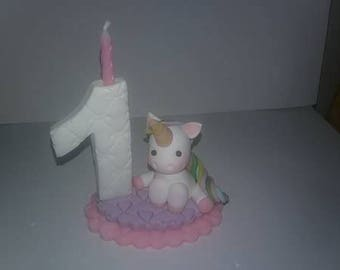 candle number with small unicorn