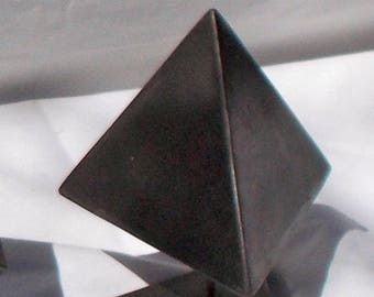 Spinning Tetrahedron ,one of the platonic solids. fun small sculpture made of iron