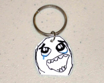 Happy Rage Guy - Internet Meme - Keychain, Cell Phone Charm, Necklace, Earrings, Stickers, Tattoos, Embroidered Patch, Magnets