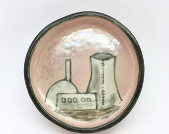 Round ceramic ringdish with a powerstation illustration and mother of pearl luster details
