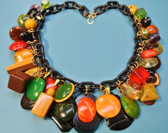Rare unique ONE-OF-A-KIND necklace with 43 multicolor pendants of genuin tested vintage 1940s bakelite plastic with black plastic chain