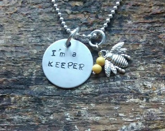 I'm a Keeper hand stamped pendant. Your choice of either Necklace or Keychain