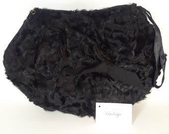 Danica 1950s large black Persian lamb muff, zippered compartment, lamb fur and felt bow, vintage French millinery