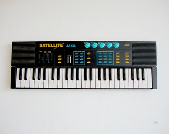 vintage synthesizer Satellite AJ-430 Music Keyboard industrial loft studio decor