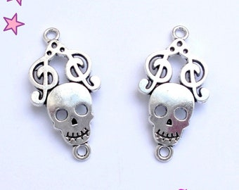 2 large 36 x 18 mm skull with treble clef silver metal connectors