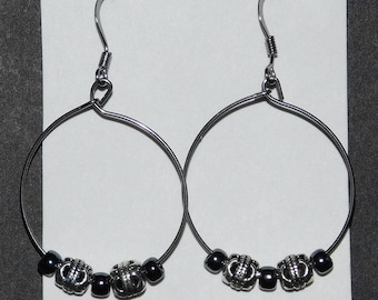 Carved silver plated beaded earrings