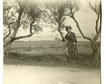 Vintage photo woman in landscape 1910