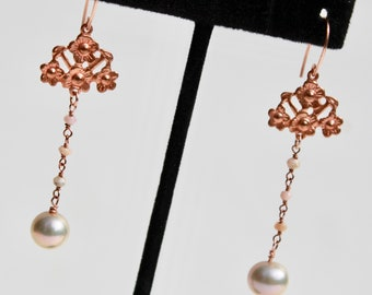 Rose gold earrings with Art Nouveau style and pale pink round pearls