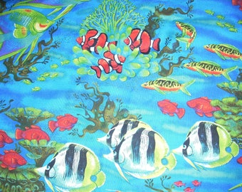 Tropical Fish on blue cotton fabric, 39 inches long by 42 inches wide